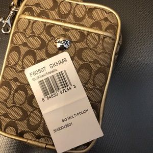 Coach Accessories - Coach cell phone case or change purse with strap